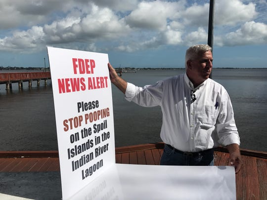 With the St. Lucie River in downtown Stuart as a backdrop Tuesday, Feb. 12, 2019, former Pahokee Mayor J.P. Sasser outlines environmental problems facing the Treasure Coast that aren't caused by Lake Okeechobee discharges. Besides defecation on spoil islands, others included high bacteria counts in the St. Lucie River and the high number of septic tanks.