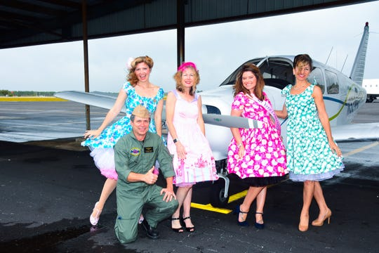 Eric Menger along with Taman Darress, Tammy Bursick, Anna Valencia Tillery and Catherine Caddell on the runway at the Vero Beach Airport