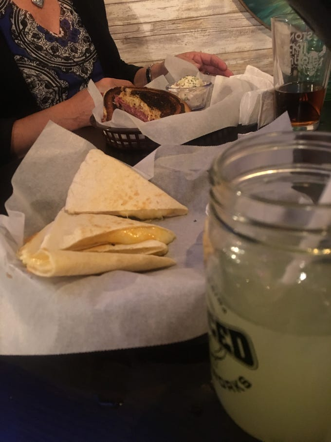 Even the adults were tempted by the child's cheese quesadilla at The Village Tavern.