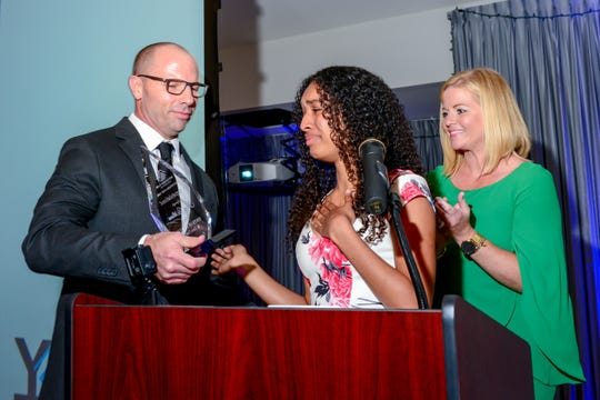Kayla Williams, center, reacts after Brian Hester, left, and Sarah Pride announce Williams as the Boys & Girls Clubs of St. Lucie County Youth of the Year for 2019. Williams represents the Ken Pruitt Club and will move on to state competition next month. Youth of Year co-chairs Hester and Pride also are Boys & Girls Clubs board members.