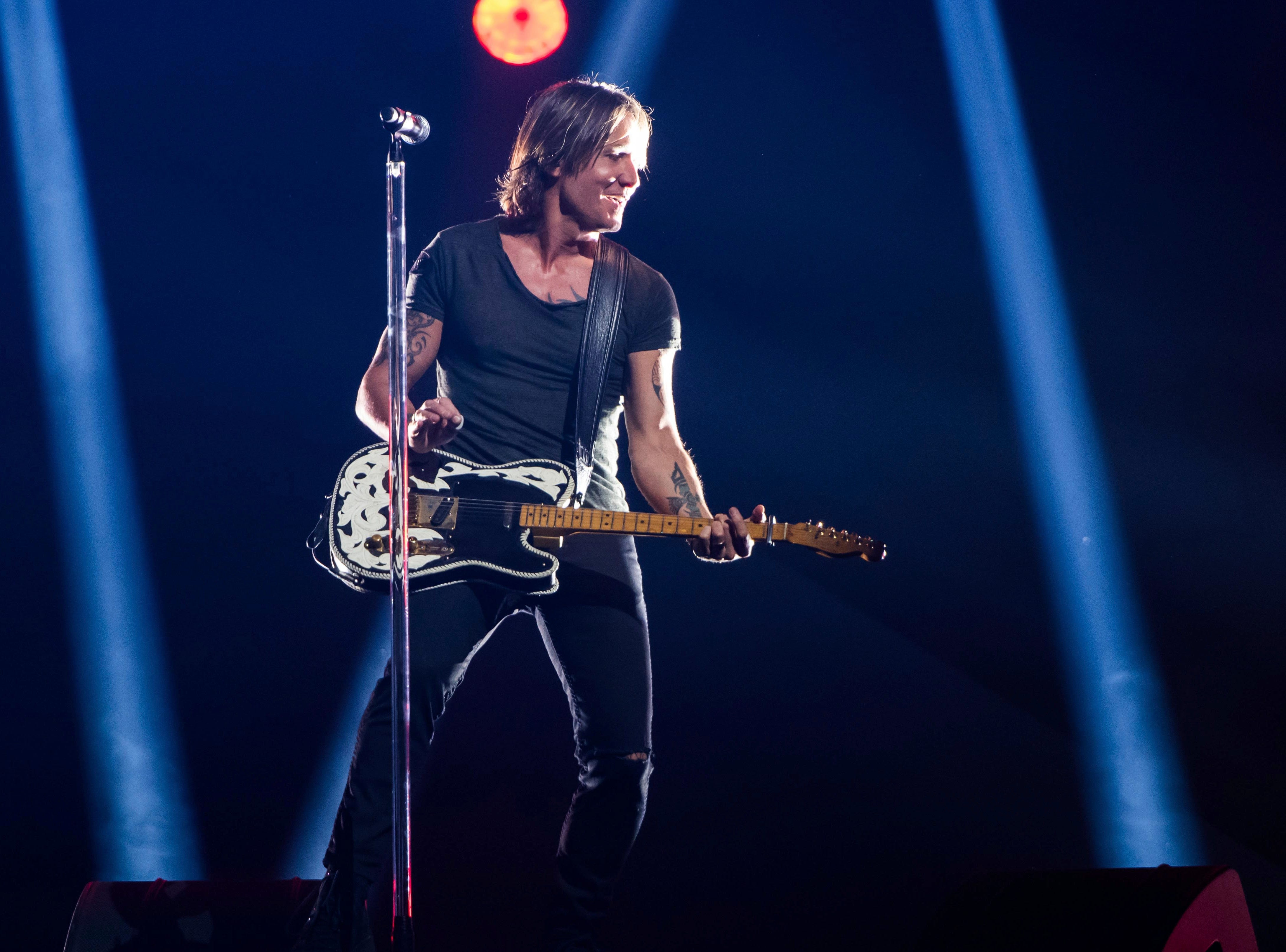 """Keith Urban performs """"Never Comin' Down"""" on Nov. 14, 2018, at the 52nd annual CMA Awards at Bridgestone Arena in Nashville, Tenn. Urban will perform at SunFest in West Palm Beach."""