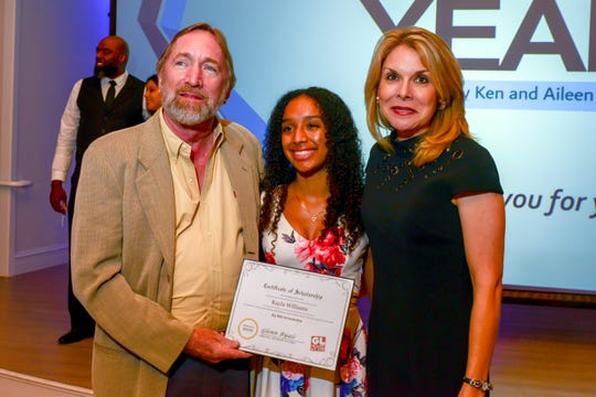 Boys & Girls Clubs of St. Lucie County 2019 Youth of Year Kayla Williams, center, accepts a $2,500 scholarship from Glenn Ryals, left, vice president of GL Homes and Sarah Alsofrom, GL Homes community relations director.