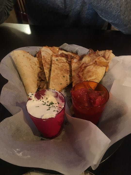 Roasted pulled pork takes center stage in The Village Tavern's pork quesadilla.