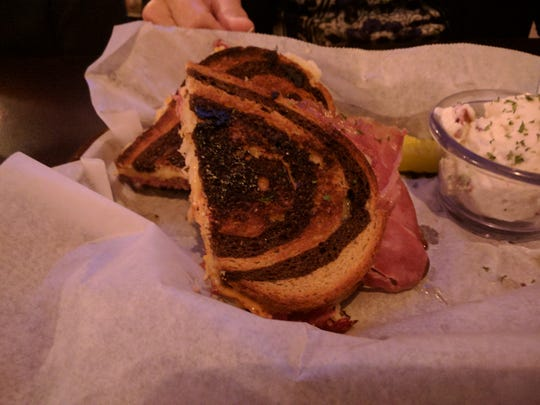 Tasty and traditional Reuben sandwiches are made with marbled rye at The Village Tavern.