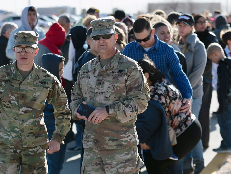 Invited guests await the arrival of President Donald Trump on Monday, Feb. 11, 2019, at the El Paso International Airport.