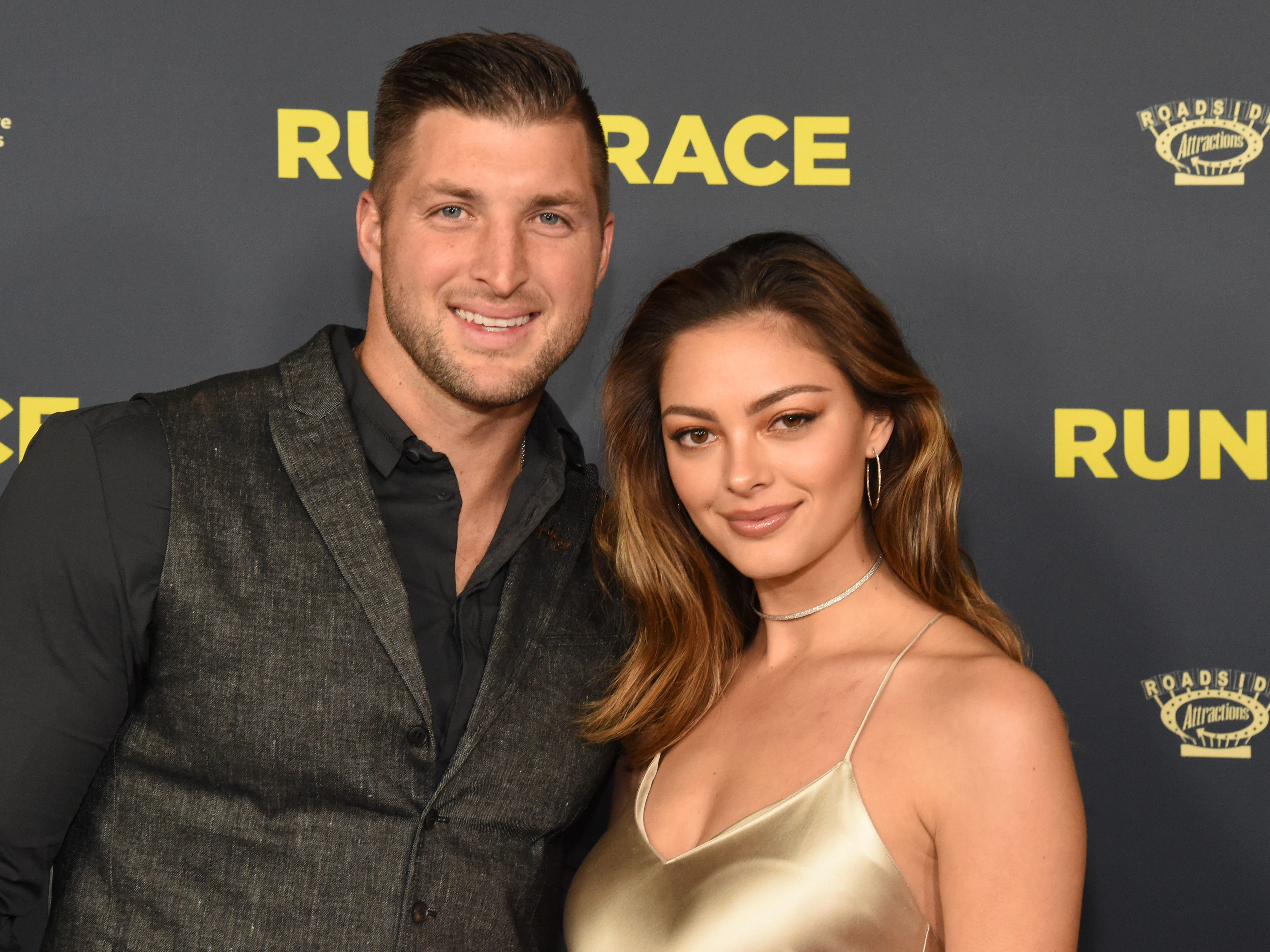 "Tim Tebow, left, and Demi-Leigh Nel-Peters attend the ""Run the Race"" world premiere at the Egyptian Theatre on Monday, Feb. 11, 2019, in Los Angeles."