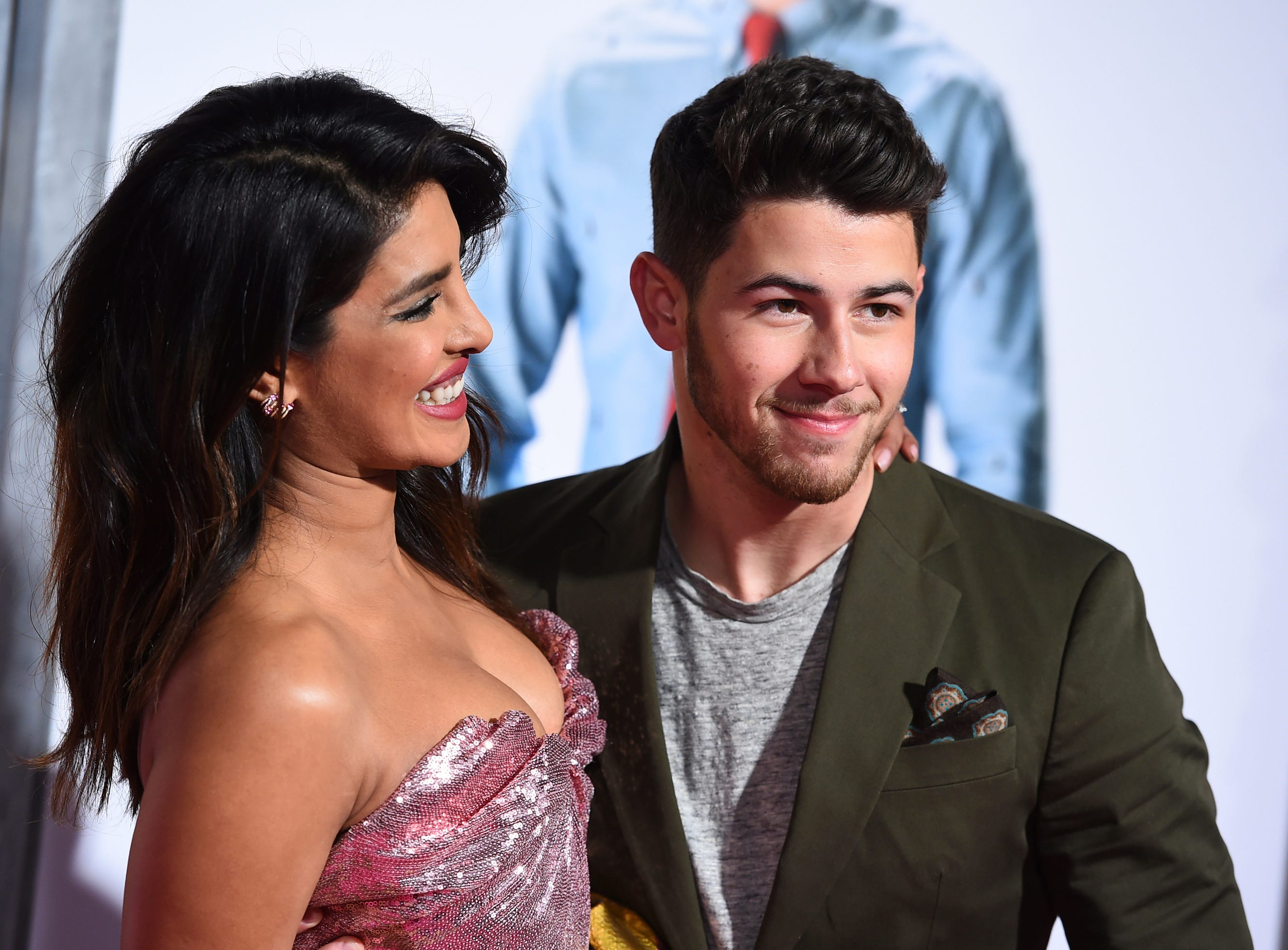 """Cast member Priyanka Chopra and her husband, Nick Jonas, arrive at the Los Angeles premiere of """"Isn't It Romantic"""" at The Theatre at Ace Hotel on Monday, Feb. 11, 2019."""