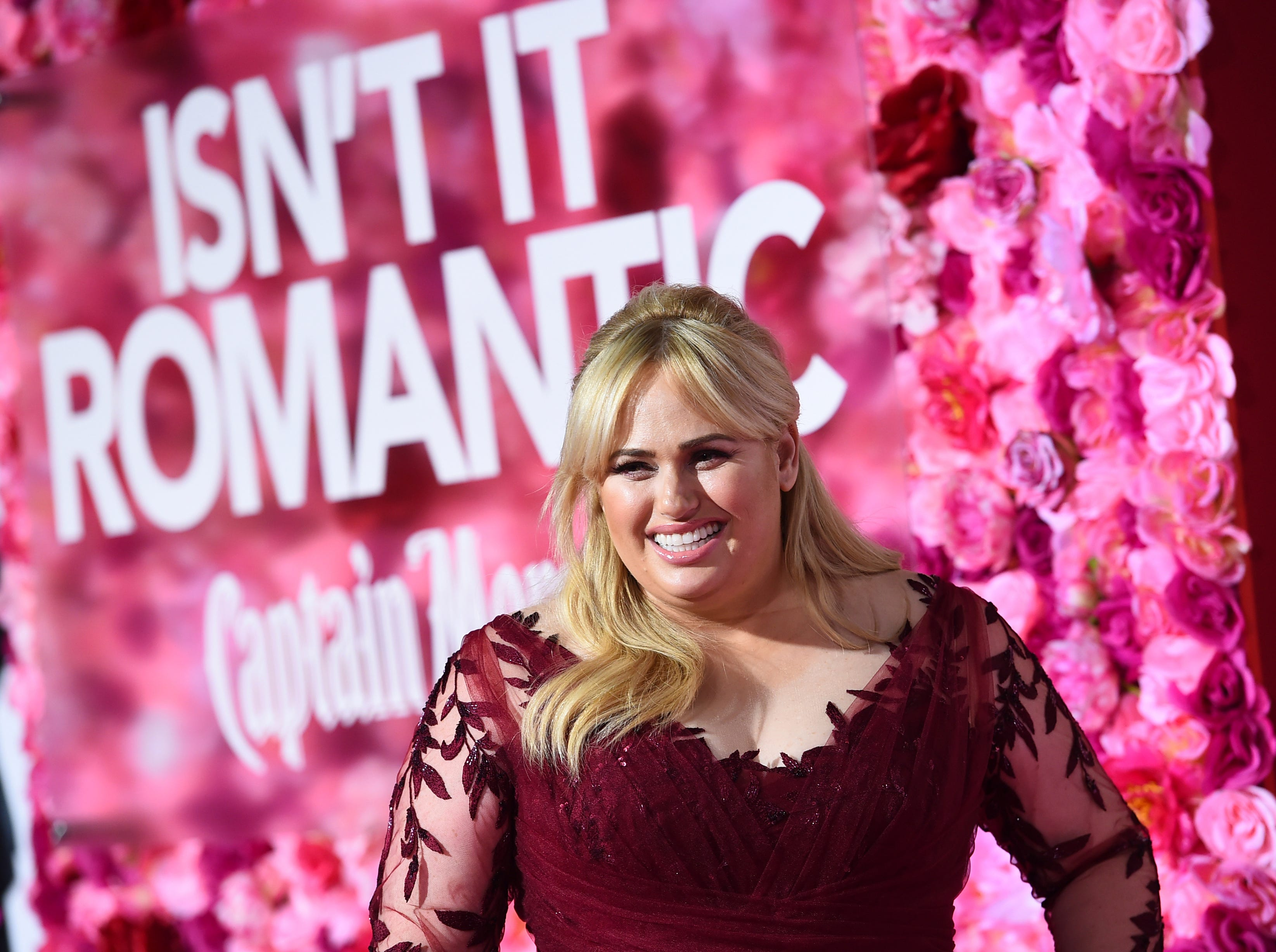 """Cast member Rebel Wilson arrives at the Los Angeles premiere of """"Isn't It Romantic"""" at The Theatre at Ace Hotel on Monday, Feb. 11, 2019."""