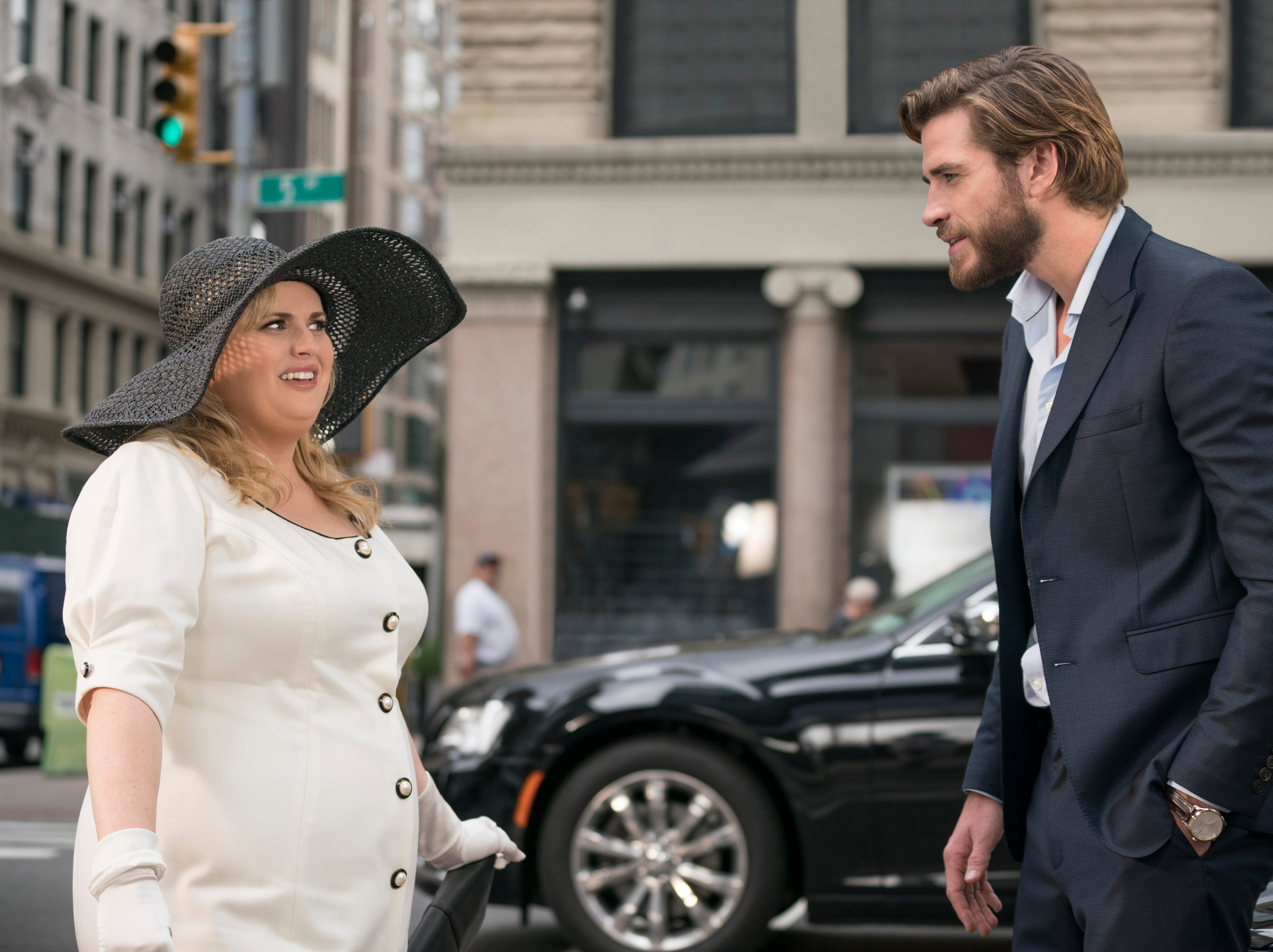 """This image released by Warner Bros. Pictures shows Rebel Wilson, left, and Liam Hemsworth in a scene from """"Isn't It Romantic."""""""