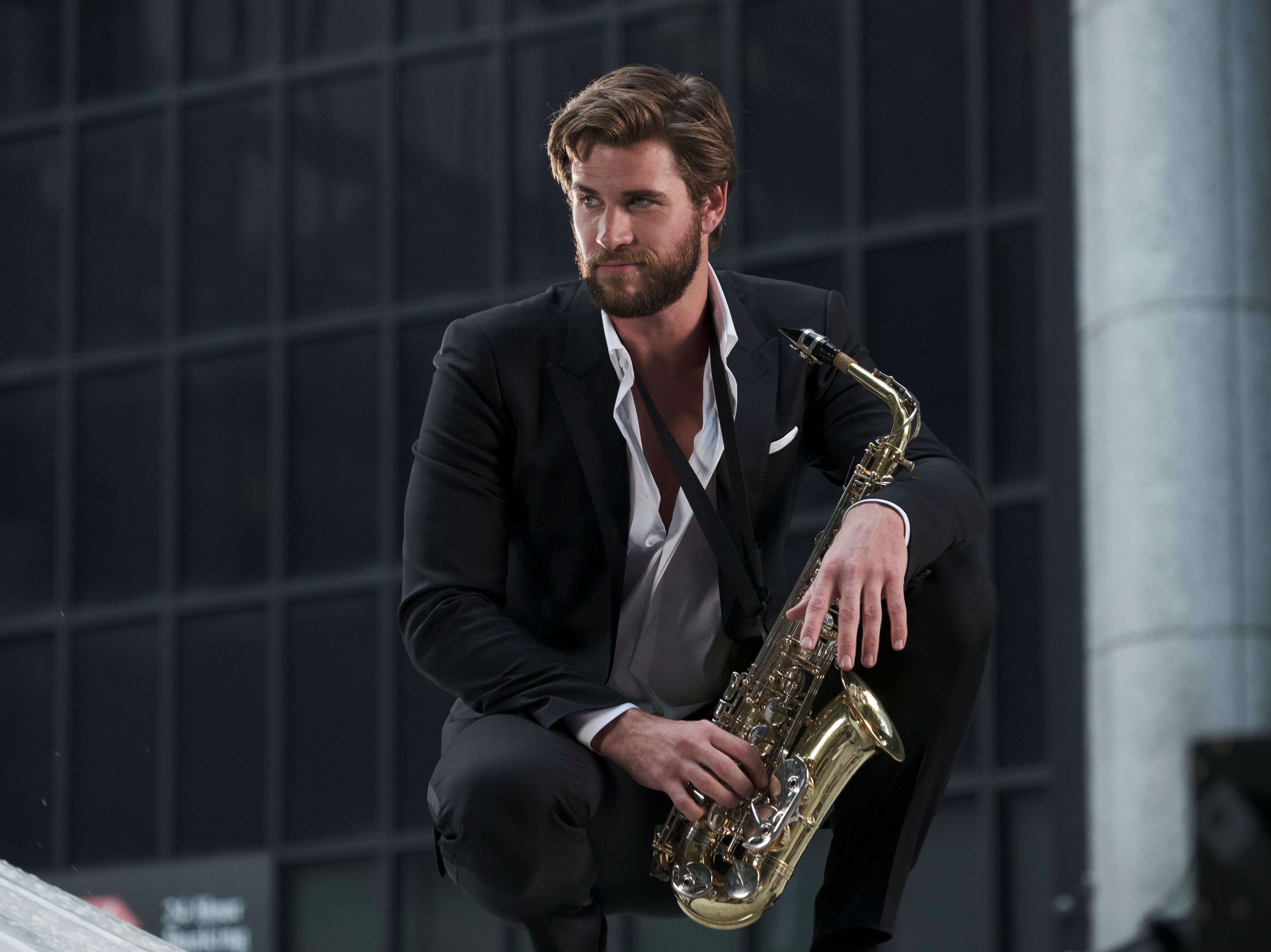"""This image released by Warner Bros. Pictures shows Liam Hemsworth in a scene from """"Isn't It Romantic."""""""