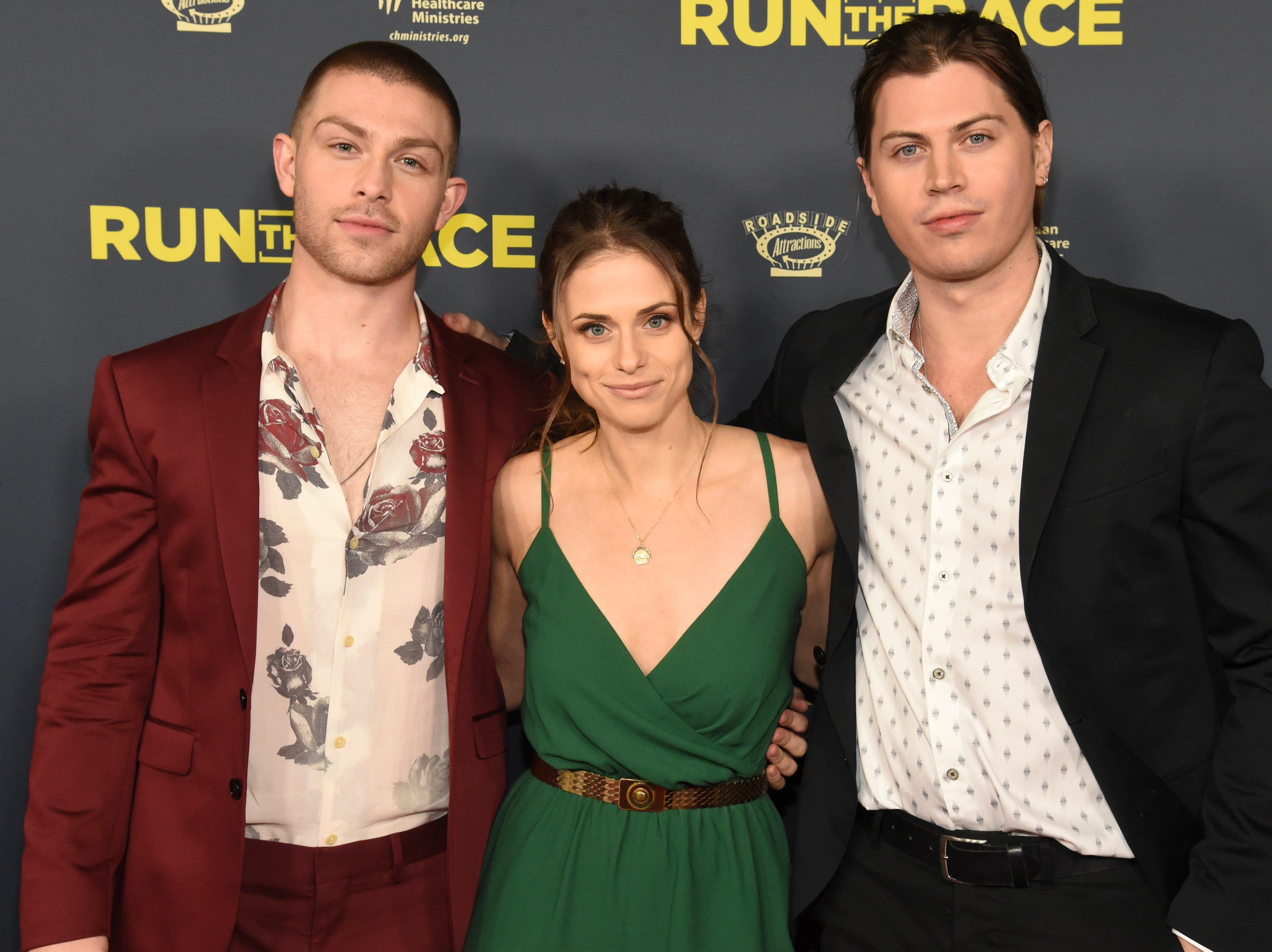 "Cast members, from left, Evan Hofer, Kelsey Reinhardt and Tanner Stine attend the ""Run the Race"" world premiere at the Egyptian Theatre on Monday, Feb. 11, 2019, in Los Angeles."