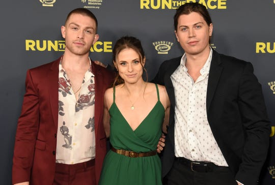 """Cast members, from left, Evan Hofer, Kelsey Reinhardt and Tanner Stine attend the """"Run the Race"""" world premiere at the Egyptian Theatre on Monday, Feb. 11, 2019, in Los Angeles."""