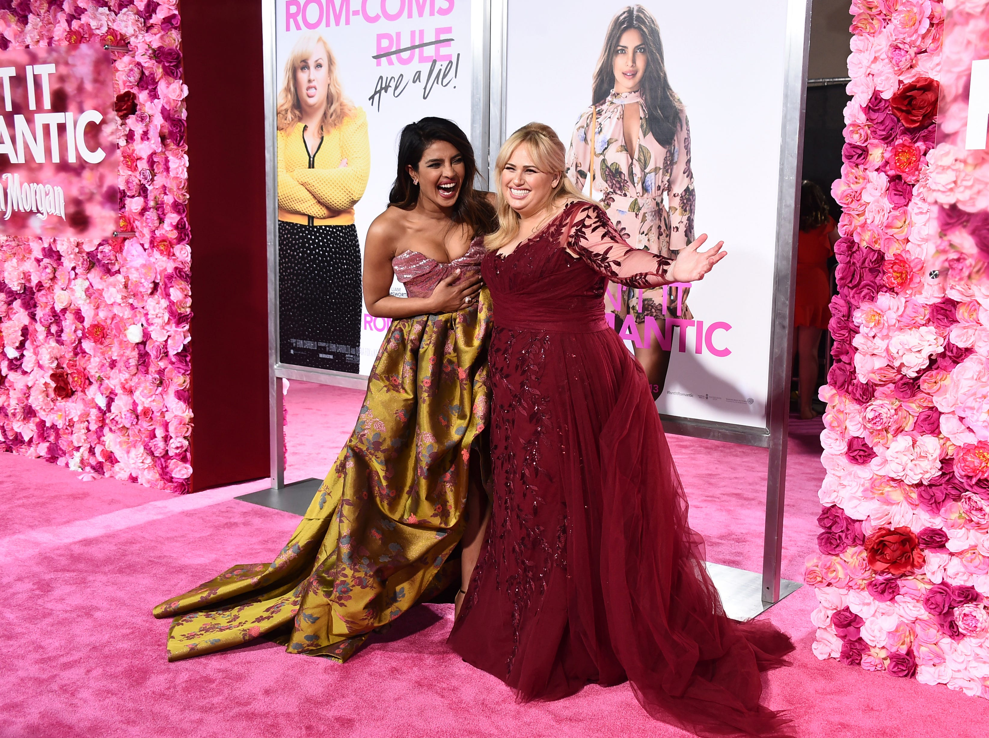 """Cast members Priyanka Chopra and Rebel Wilson arrive at the Los Angeles premiere of """"Isn't It Romantic"""" at The Theatre at Ace Hotel on Monday, Feb. 11, 2019."""