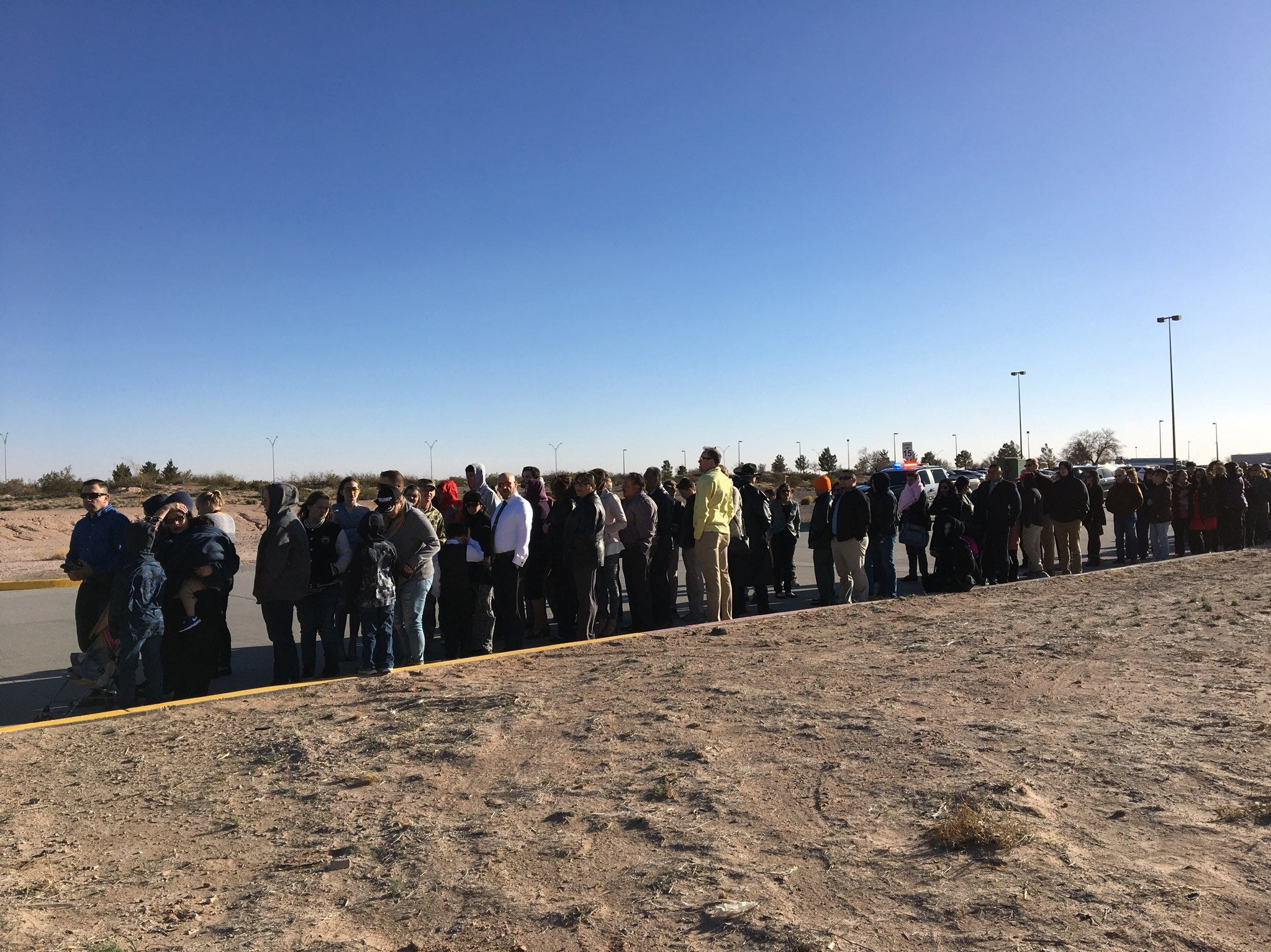 About 100 invited guests line up Monday for the arrival of President Donald Trump at the El Paso International Airport.