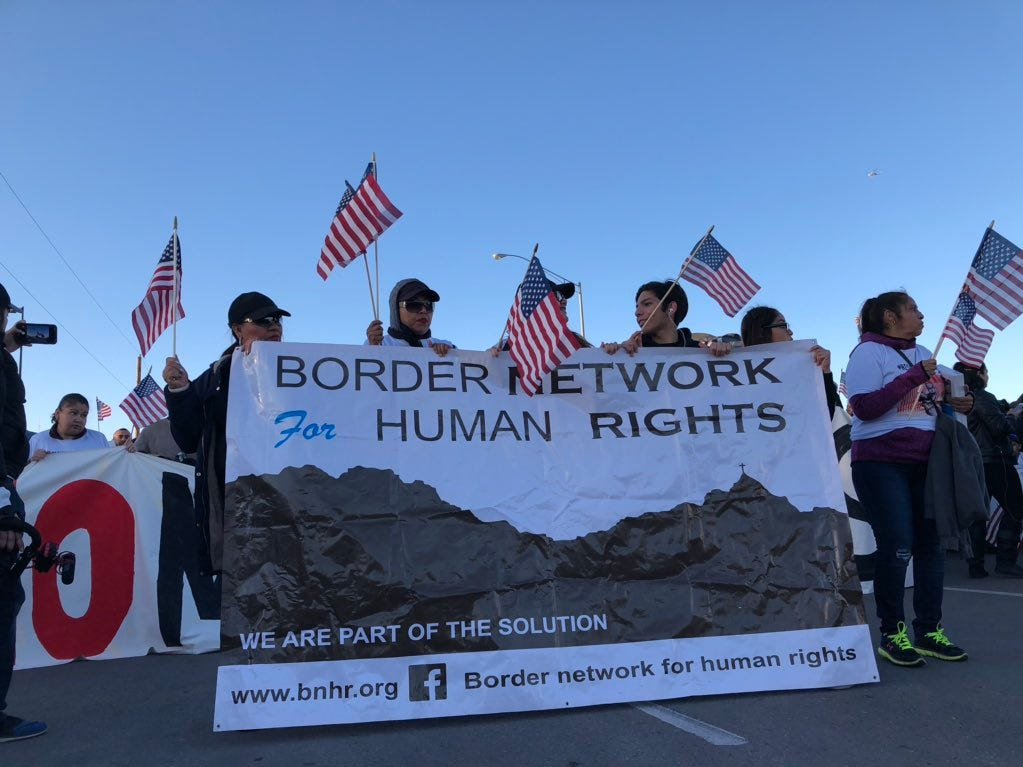 """Thousands join the counter-rally Monday in El Paso, chanting, """"Reforma si, el muro no!"""" (Reform yes, the wall no)."""