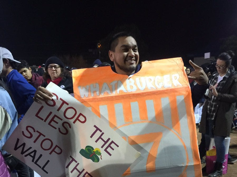A Whataburger fan shows up at the counter-rally Monday, Feb. 11, 2019, in El Paso.