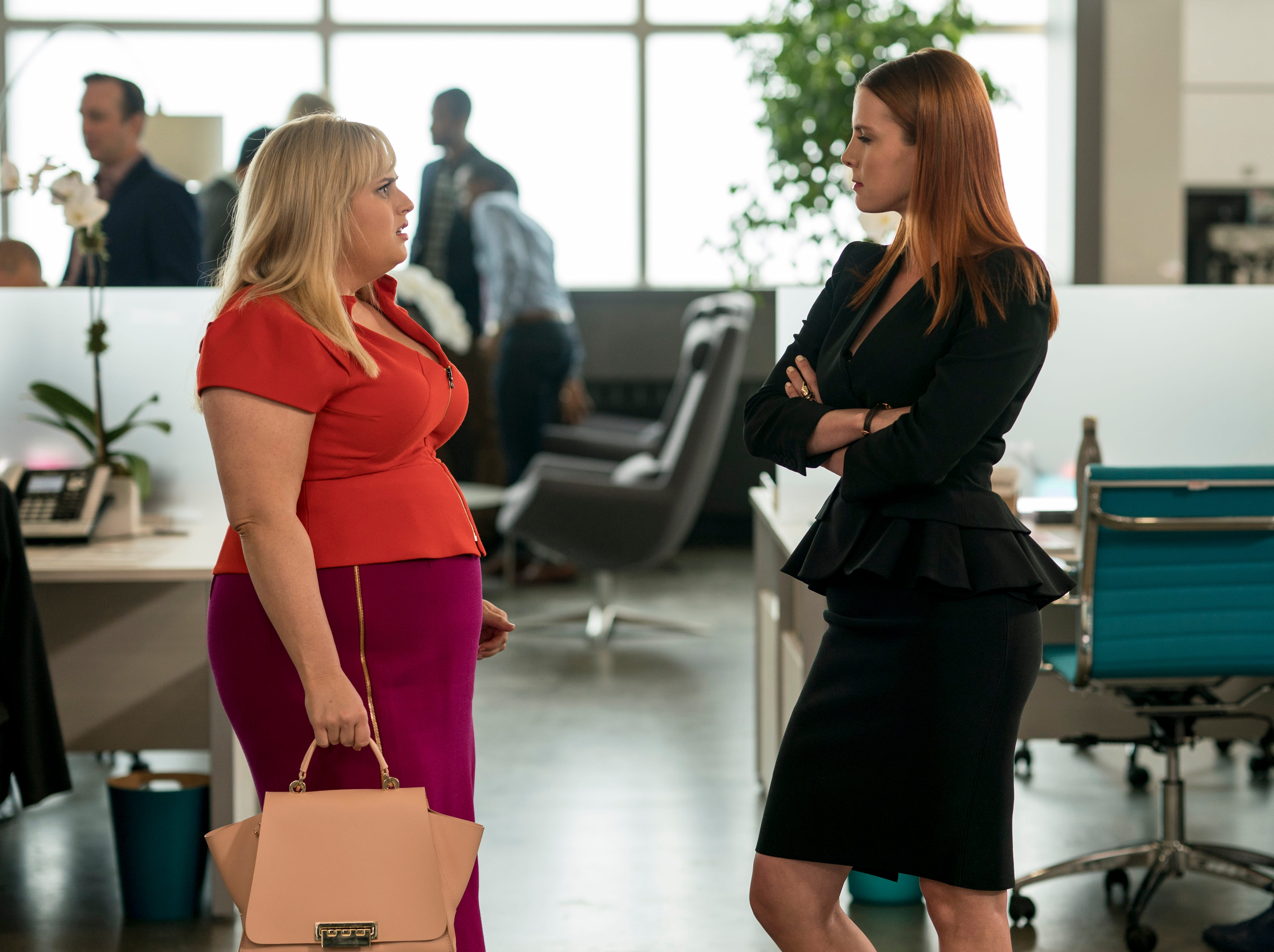 """This image released by Warner Bros. Pictures shows Rebel Wilson, left, and Betty Gilpin in a scene from """"Isn't It Romantic."""""""