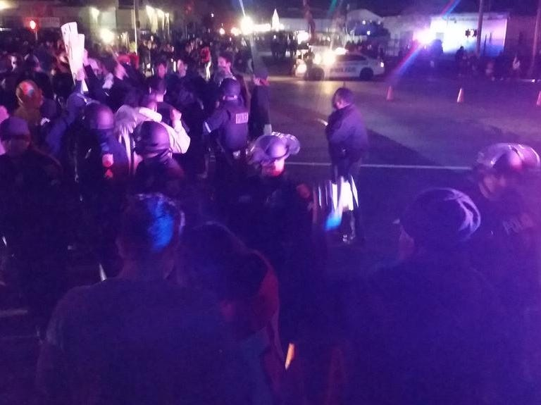 Police break up a confrontation outside the El Paso County Coliseum on Monday, Feb. 11, 2019.