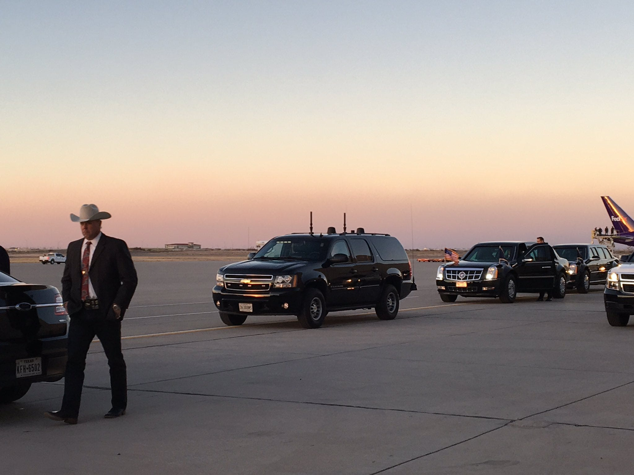 Dignitaries wait for the president Monday at the El Paso International Airport.