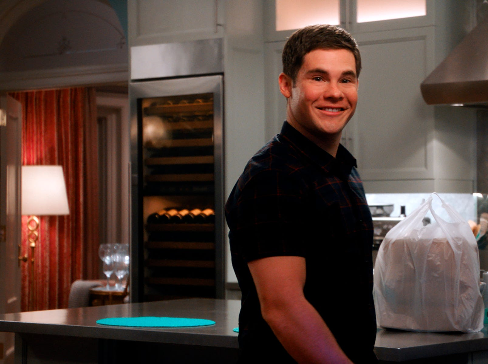 """This image released by Warner Bros. Pictures shows Adam Devine in a scene from """"Isn't It Romantic."""""""