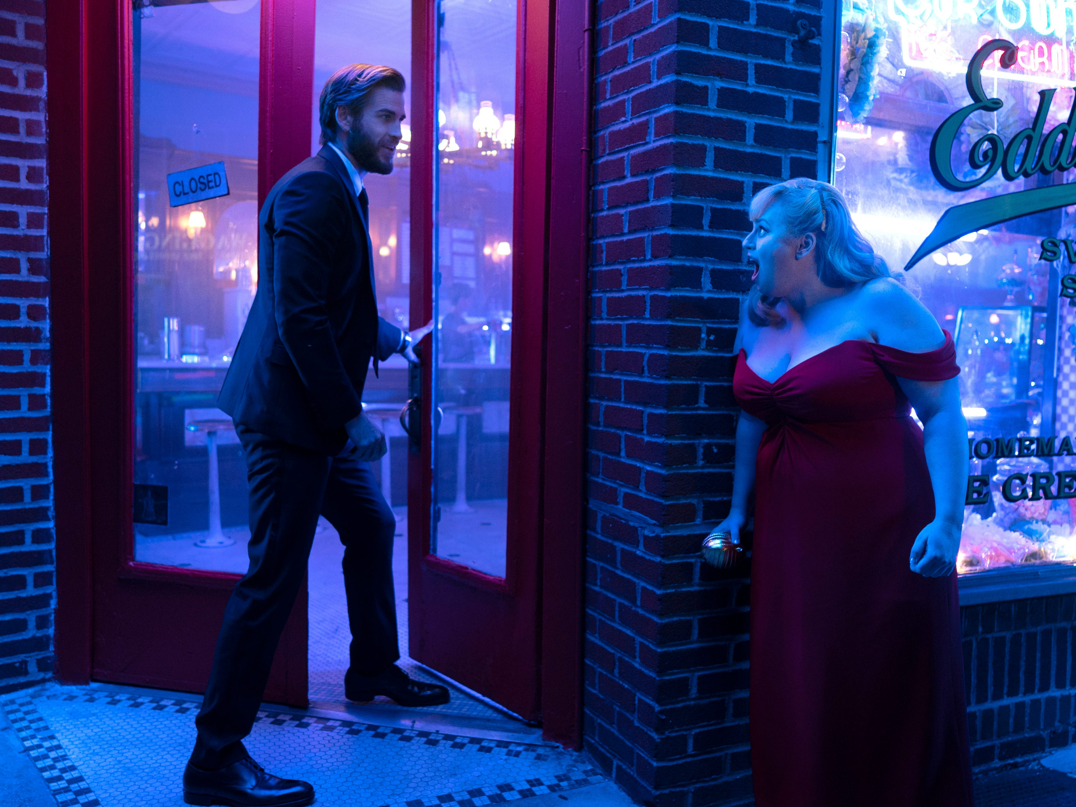 """This image released by Warner Bros. Pictures shows Rebel Wilson, right, and Liam Hemsworth in a scene from """"Isn't It Romantic."""""""