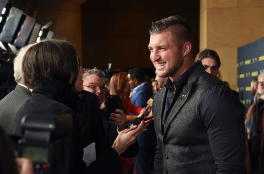 "Tim Tebow is interviewed at the ""Run the Race"" world premiere at the Egyptian Theatre on Monday, Feb. 11, 2019, in Los Angeles."
