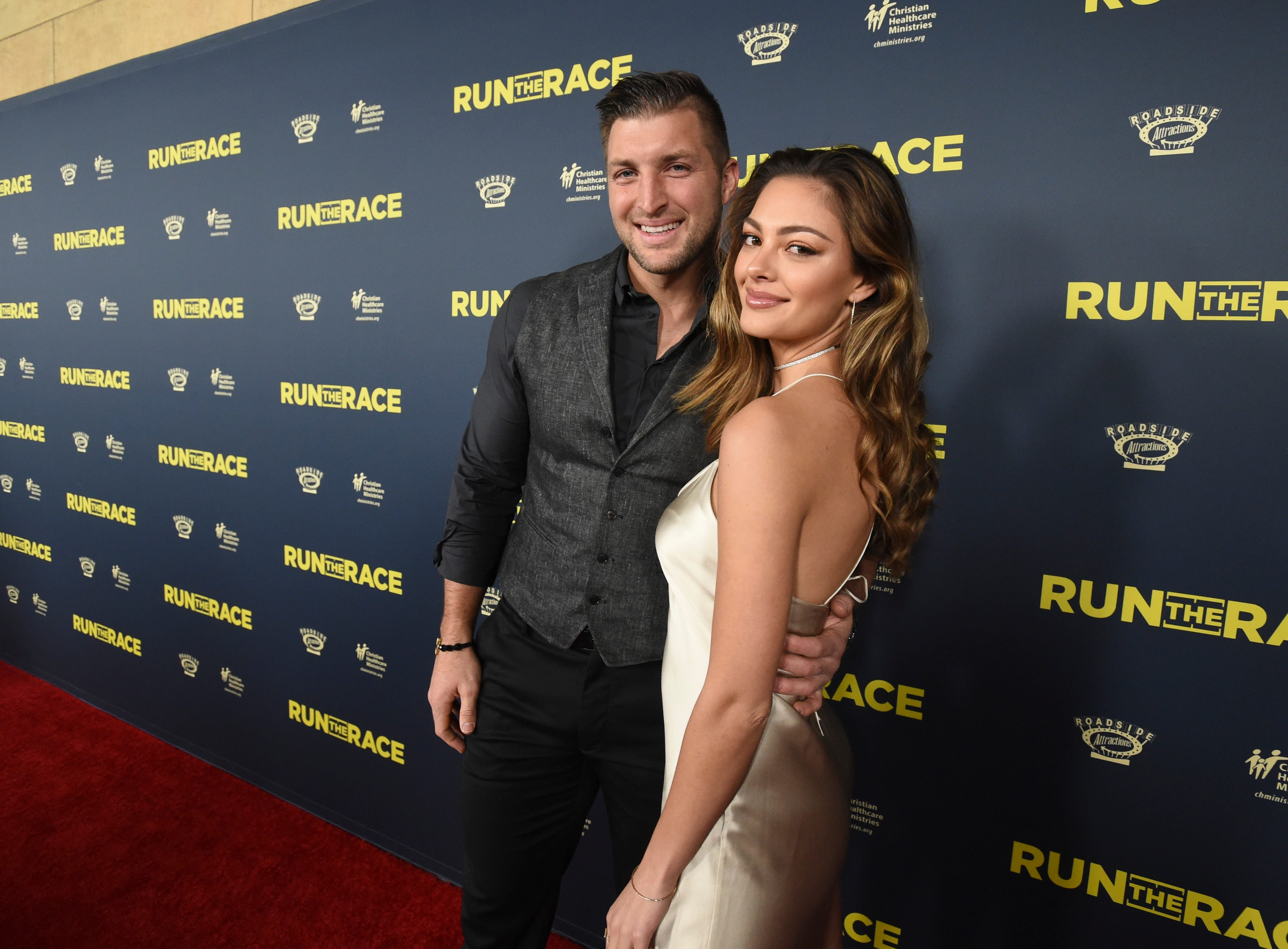 "Tim Tebow, left, and Demi-Leigh Nel-Peters attend the ""Run the Race"" world premiere held at the Egyptian Theatre on Monday, Feb. 11, 2019, in Los Angeles."