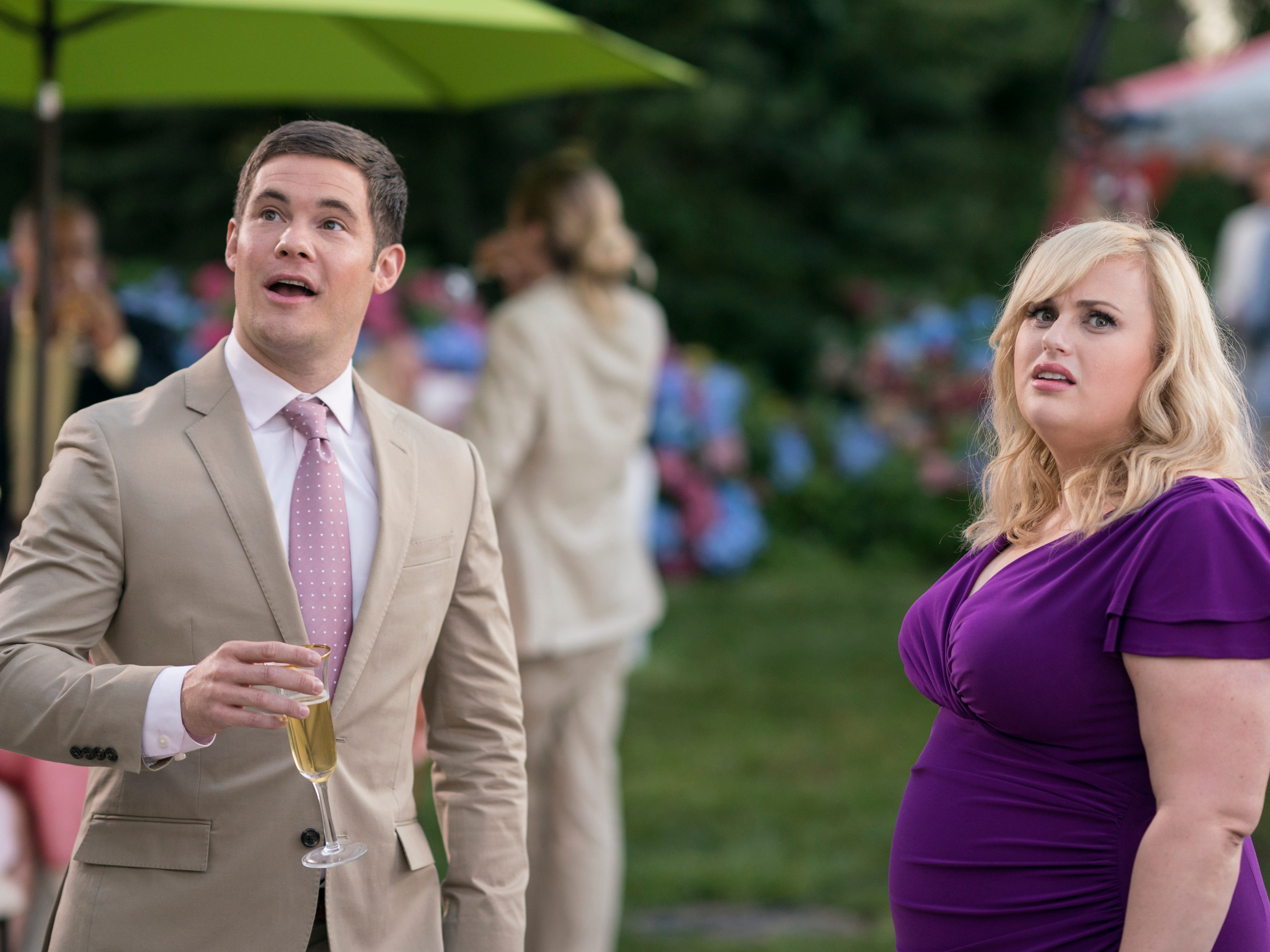 """This image released by Warner Bros. Pictures shows Adam Devine, left, and Rebel Wilson in a scene from """"Isn't It Romantic."""""""