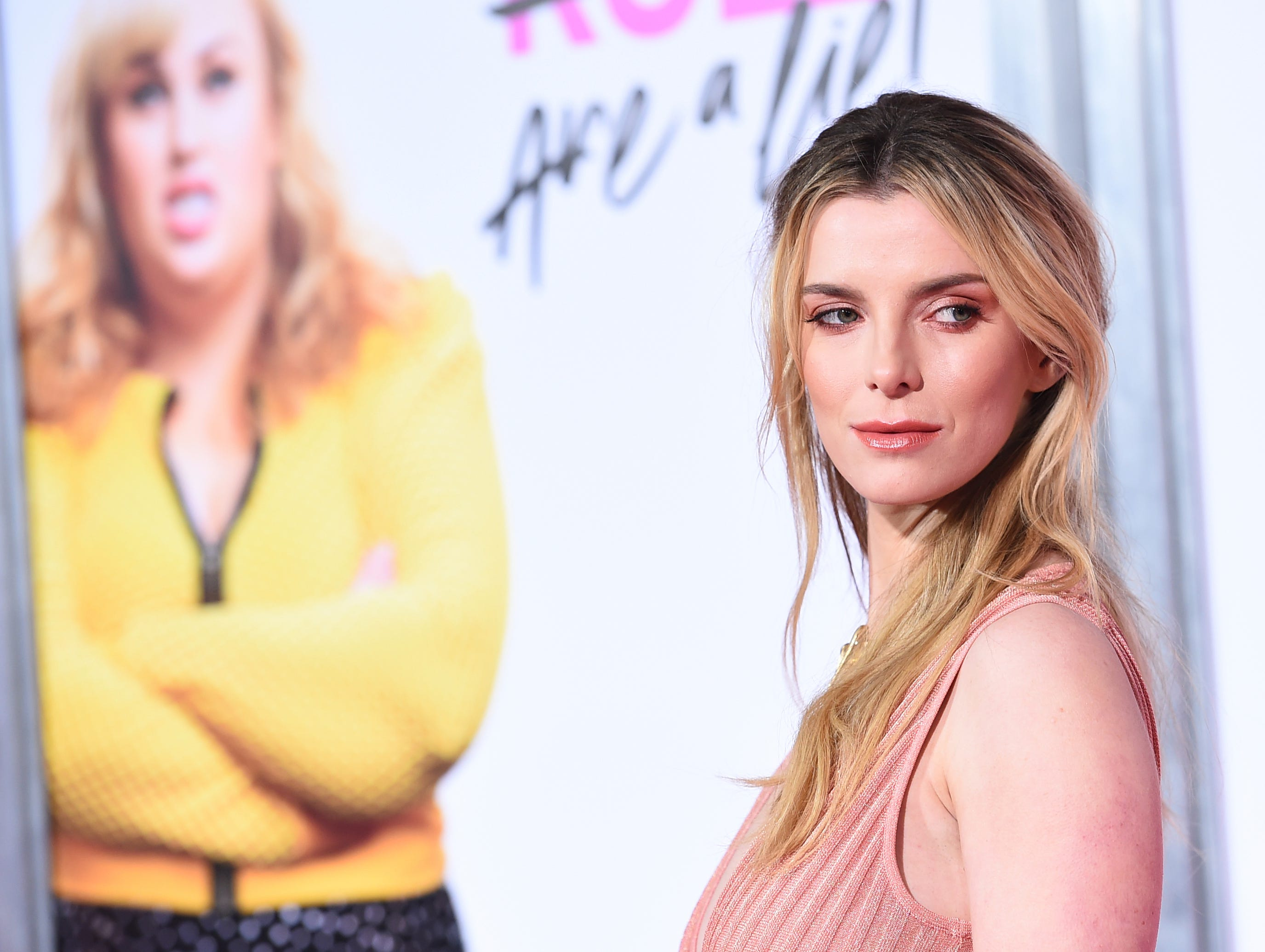 """Cast member Betty Gilpin arrives at the Los Angeles premiere of """"Isn't It Romantic"""" at The Theatre at Ace Hotel on Monday, Feb. 11, 2019."""