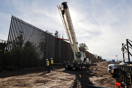In this March 5, 2018, file photo, construction continues on a new, taller version of the border structure in Calexico.
