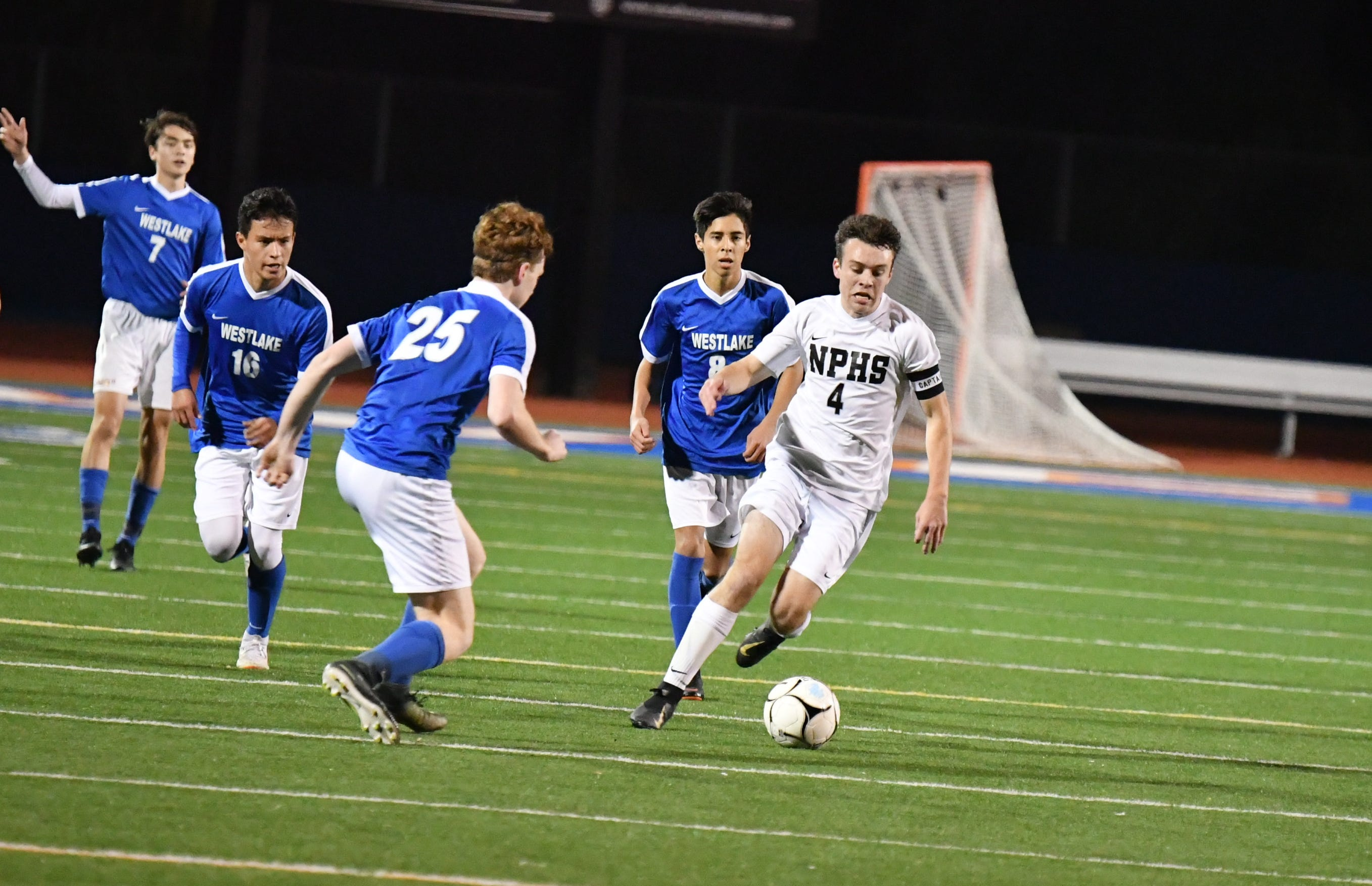 Junior attacking midfielder Luke Varav, shown being chased by opponents earlier this season during a 7-1 win at Westlake, has six goals and a team-high 16 assists for the Newbury Park High boys soccer team.