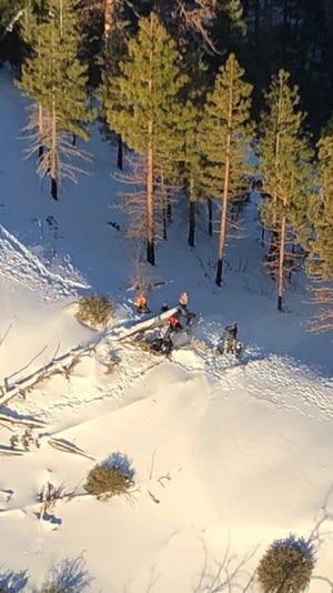 A helicopter view of six motorcyclists stuck in snow atop Alamo Mountain who were rescued volunteers from the Ventura County Sheriff's Fillmore search-and-rescue team Monday.