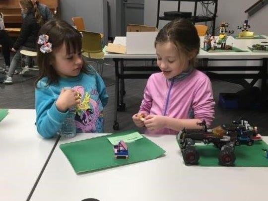 Amanda Cugino (left)and Kiersten Swain participated in the Cumberland County 4-H Lego Palooza.