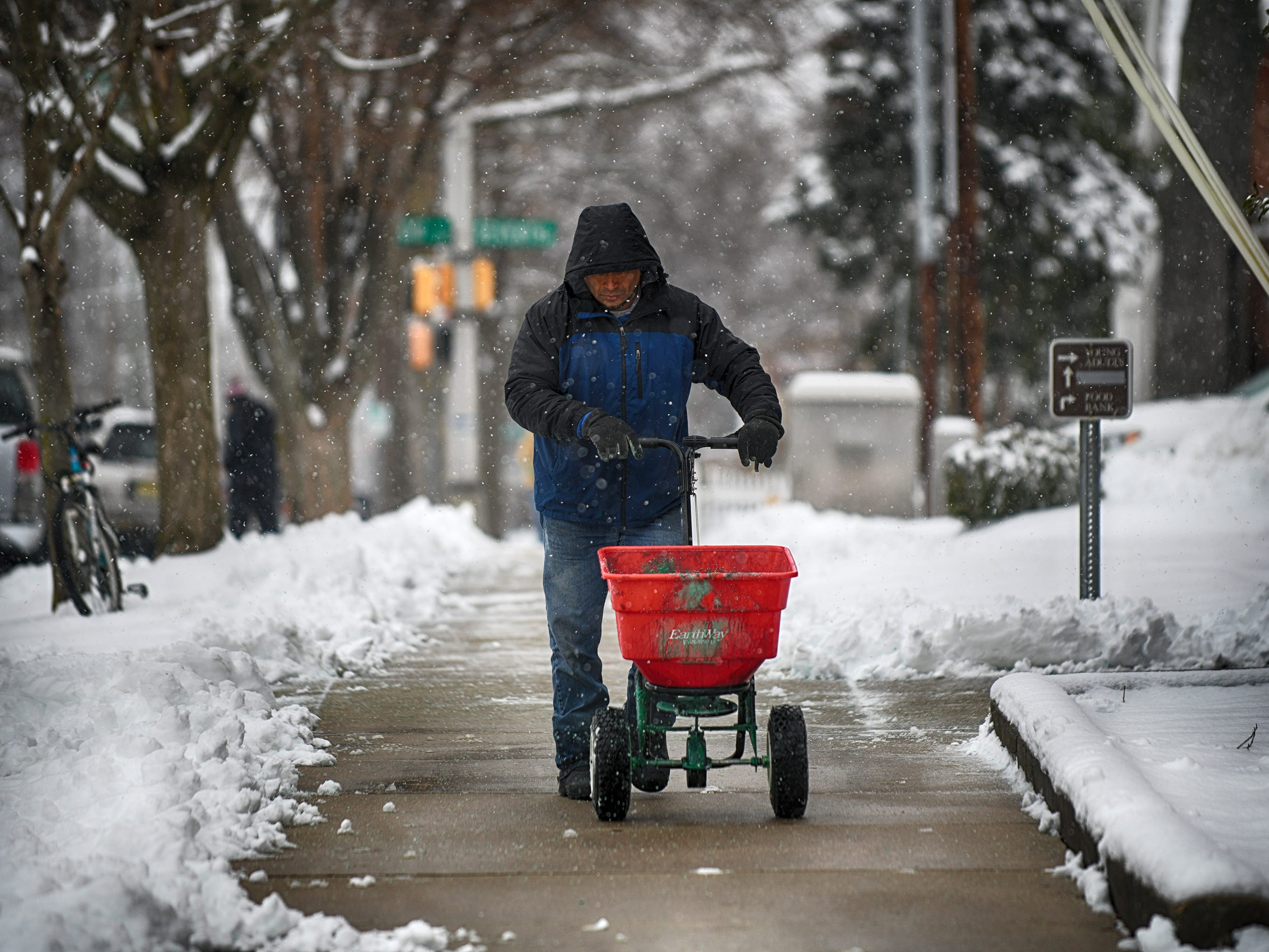 A worker clears the sidewalk of snow outside the First United Methodist Church soup kitchen in Vineland on Monday, Feb. 11, 2019.