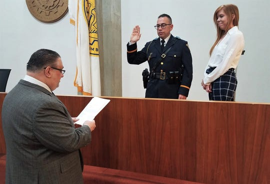 Pedro Casiano is sworn in as Vineland Deputy Police Chief by Mayor Anthony Fanucci at City Hall on Monday, Feb. 11, 2019. Casiano's wife, Rachel, stands by his side during the oath.