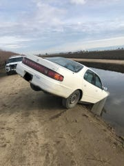 Tulare County fire and sheriff's department responded to a vehicle into a canal in Tulare on Tuesday, February 12, 2019.