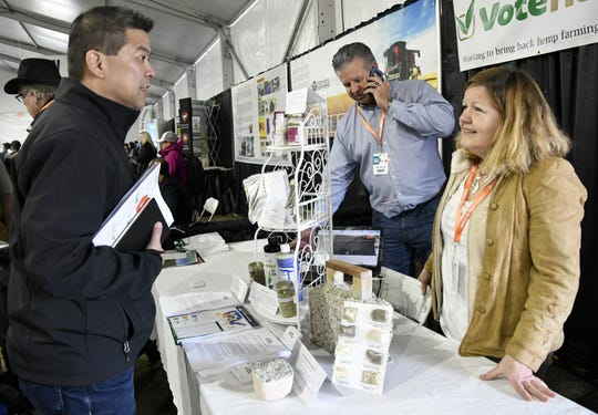 Jean Johnson, California outreach director for Vote Hemp, speaks with an attendant at the World Ag Expo on Tuesday, February 12, 2019.