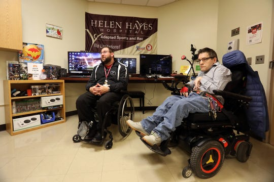 Adaptive sports coordinator Peter Gagliardo, left, with volunteer Marc Simons, talks about the adaptive gaming room at the Helen Hayes Hospital Feb. 11, 2019 in Stony Point.