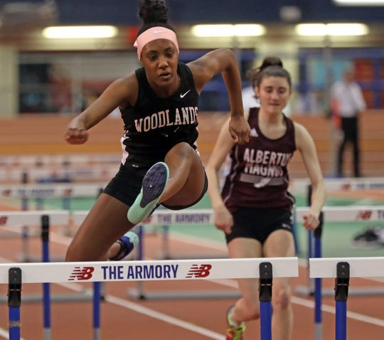 Zoe Denton of Woodlands wins the Girls 55 Meter Hurdles during Section 1 Class C Championships at The Armory in Manhattan Feb. 11, 2019.