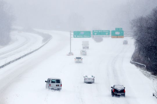 Traffic crawls along southbound I-684 at the Saw Mill interchange in Katonah during a steady snowfall Feb. 12,  2019.