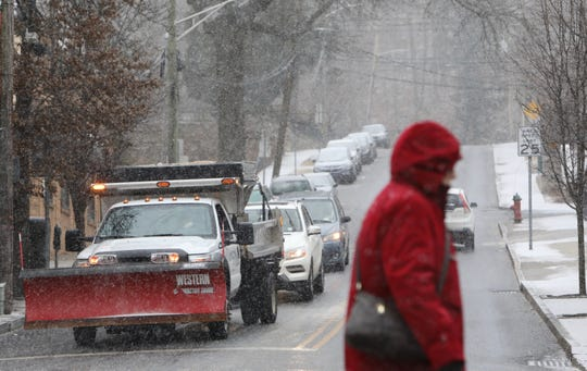 DPW workers salt the roads as snow begins to fall in Tarrytown, around 9:15 a.m. on Feb. 12, 2019.