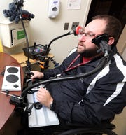 Peter Gagliardo, the adaptive sports coordinator at Helen Hayes Hospital, demonstrates some of the equipment for people with limited movement in their adaptive gaming room Feb. 11, 2019 in Stony Point.