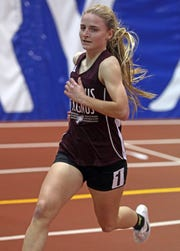 Claire Gardner of Albertus Magnus wins the Girls 1500 Meter Run during Section 1 Class C Championships at The Armory in Manhattan Feb. 11, 2019.