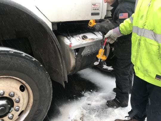 Workers removed latex gloves that were stuffed into gas tanks of Mount Vernon DPW trucks overnight including most of the city's snow plows and salt spreaders.