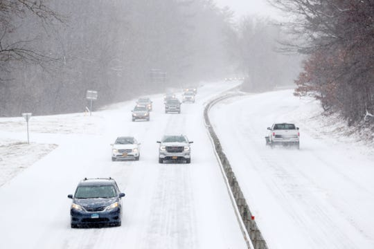 Traffic crawls along the Saw Mill River Parkway in Bedford Hills during a steady snowfall Feb. 12,  2019.