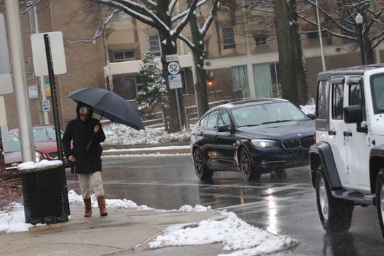 Icy, rainy weather still was falling over Wilmington early Tuesday morning.