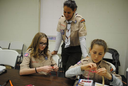 Troop 43 Scoutmaster Maja Spadin, center, helps Scouts Adele McCormick, left, and Rachel Spadin Monday night  as they practice whipping rope ends at a meeting at University United Methodist Church. Two all-female BSA troops opened in Wichita Falls with official meetings that began Feb. 1.