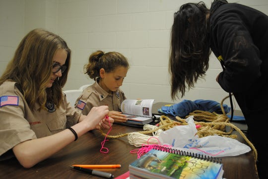 Adele McCormick, left, Rachel Spadin, center, and Sara Russell practice whipping rope ends at the BSA Troop 43 meeting Monday night at University United Methodist Church. Two troops opened in Wichita Falls and began official meetings Feb. 1, after the national BSA organization allowed females into the program.