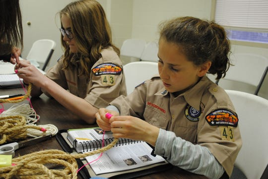 Adele McCormick, left, and Rachel Spadin practice whipping rope ends at the BSA Troop 43 meeting Monday night at University United Methodist Church. Two troops opened in Wichita Falls and began official meetings Feb. 1, after the national BSA organization allowed females into the program.
