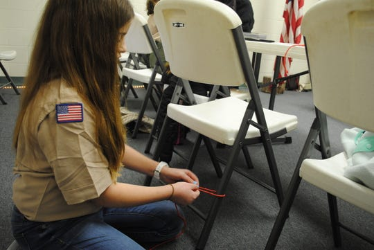 Adele McCormick practices tying various  knots in a rope during a BSA Scout Troop 43 meeting Monday night at University United Methodist Church. Two troops opened in Wichita Falls and began official meetings Feb. 1, after the national BSA organization allowed females into the program.
